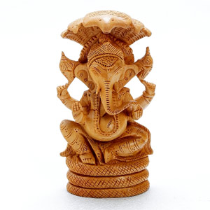 Wooden Idols-Mooladhara Ganapati Crafted in Pure White Wood