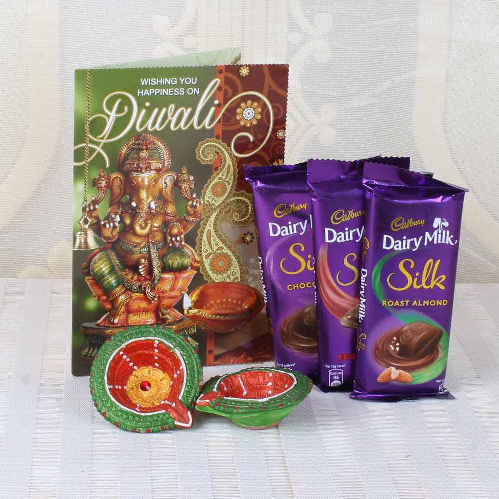 Flowers with Chocolates-Diwali Silk Chocolates Hamper of Greeting Card with Earthen Diyas
