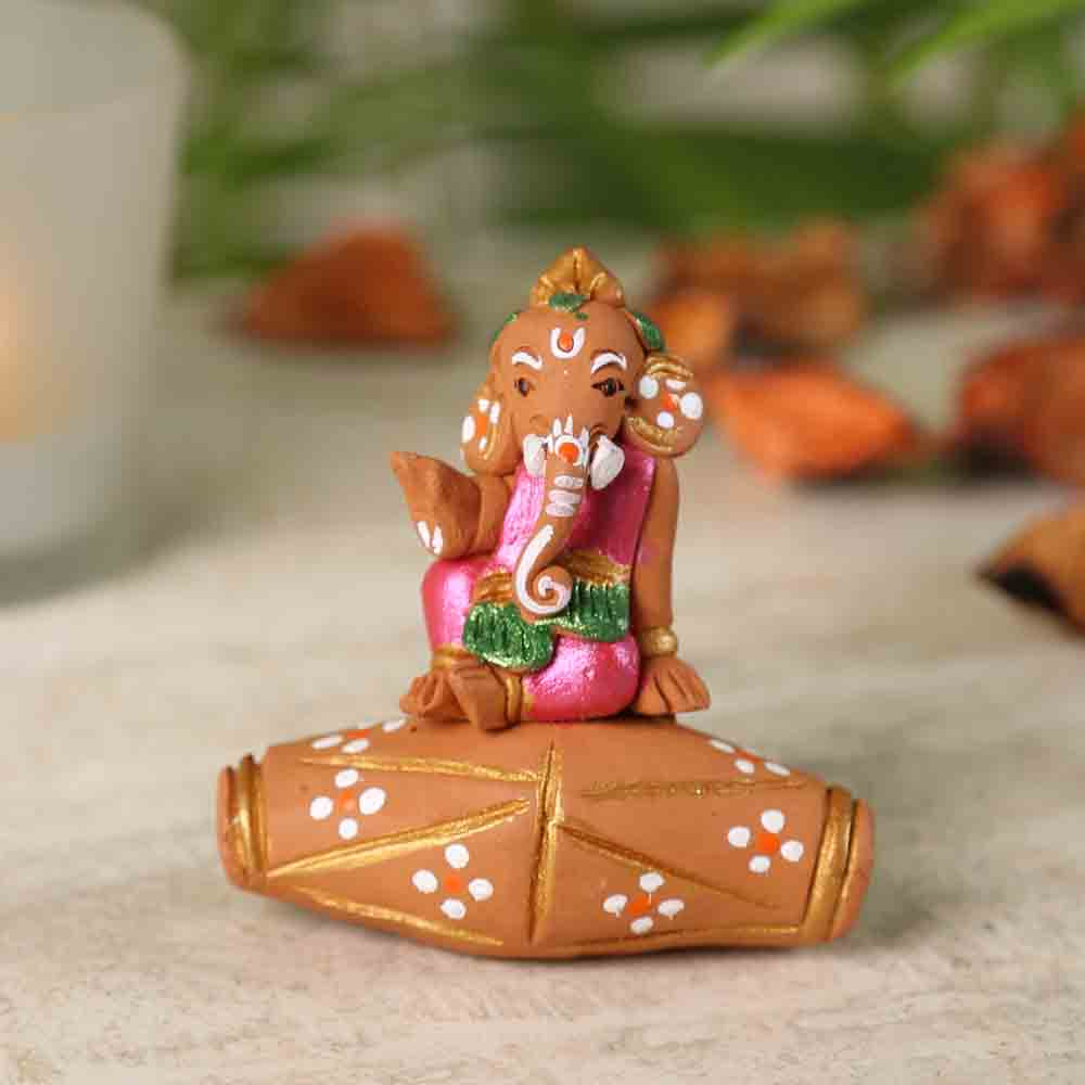 Terracotta Ganesh sitting on Dholak Showpiece