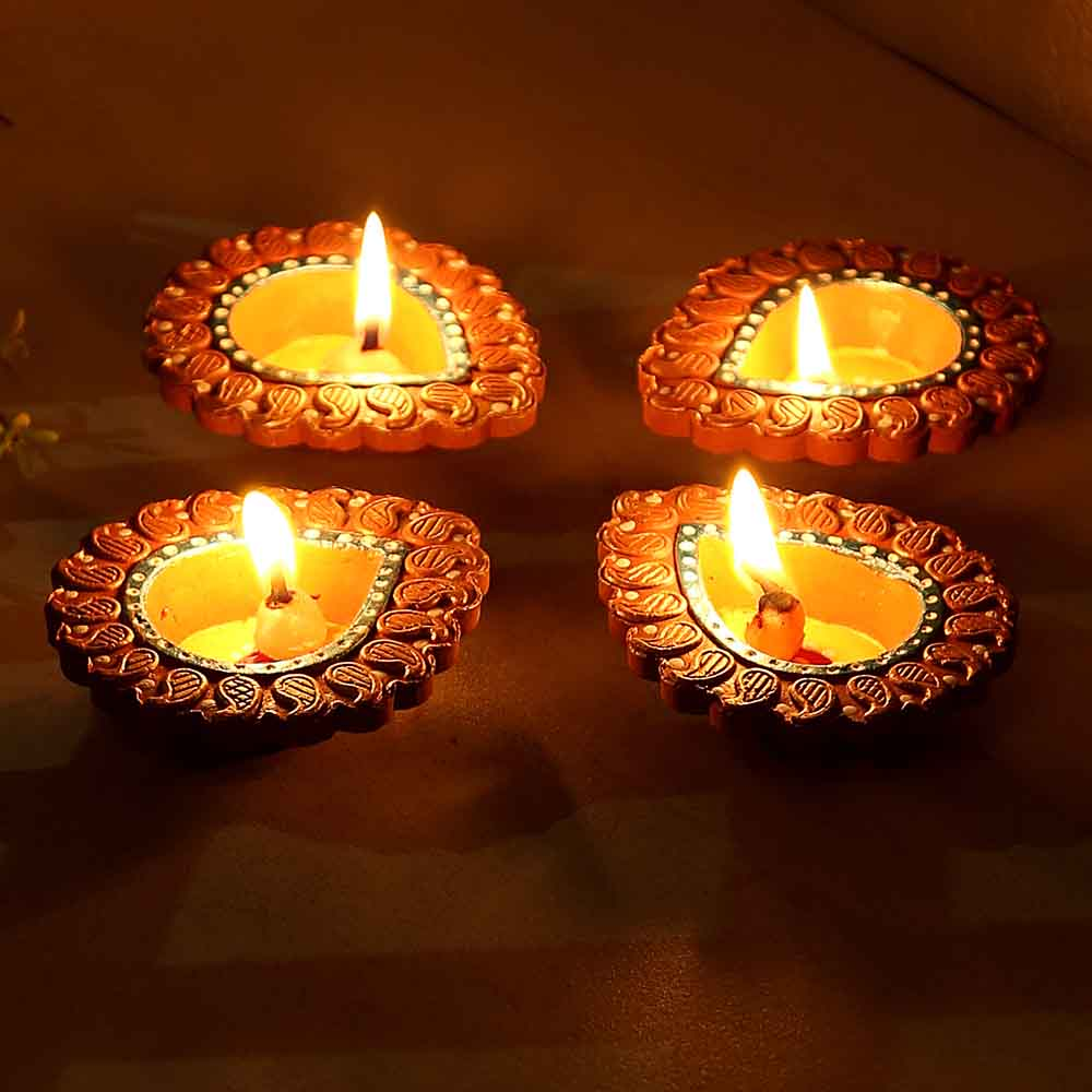 Delicately Carved Terracotta Diyas - Set Of 4