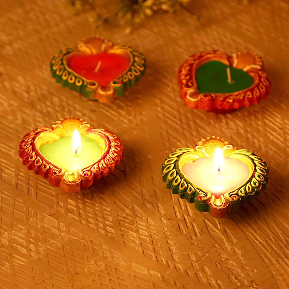 Multicoloured Wax Filled Terracotta Diyas-Set Of 4