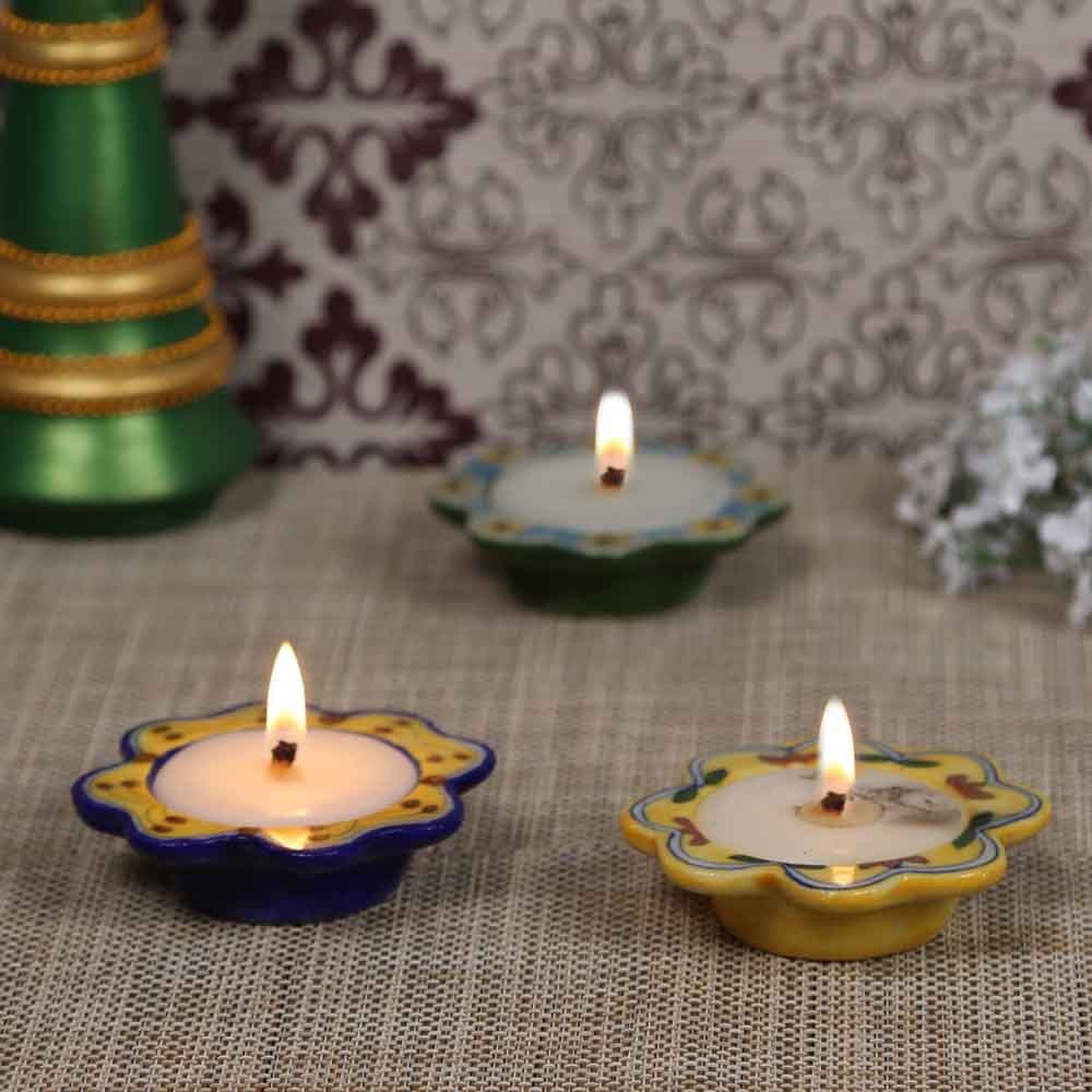 Beautiful Floral Shape Wax Filled ceramic Candle Diyas - set of 3