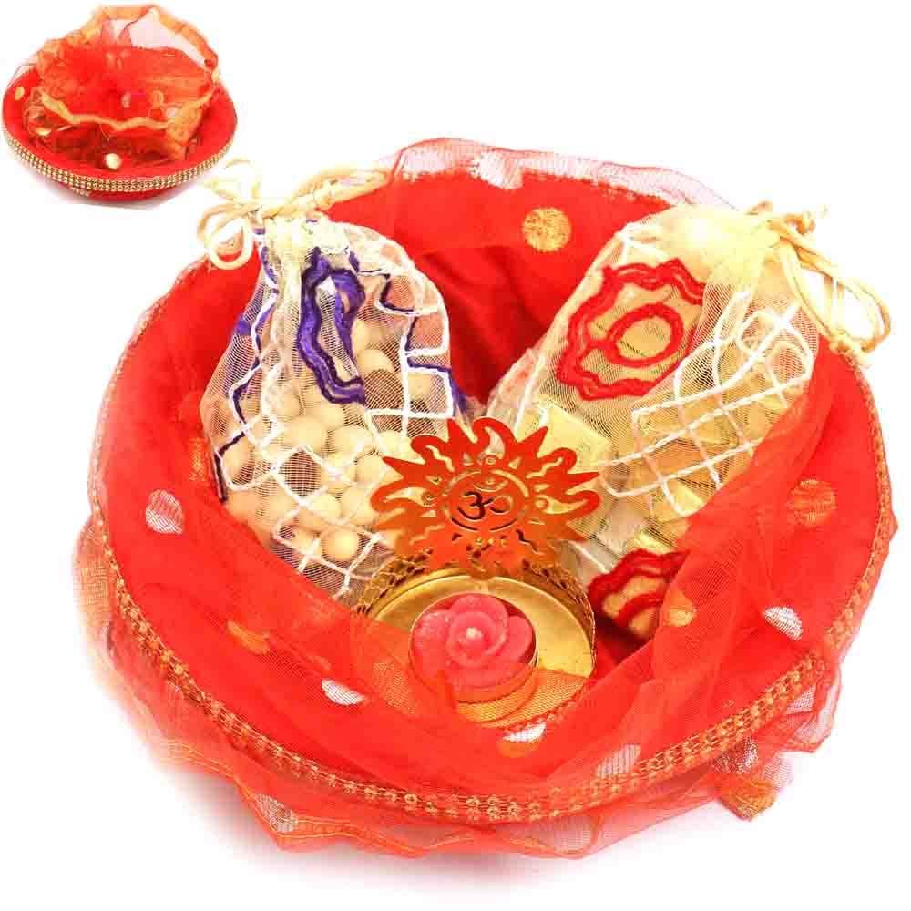 Red Potli Basket with Chocolate, Nutties Pouches and Om t-lite