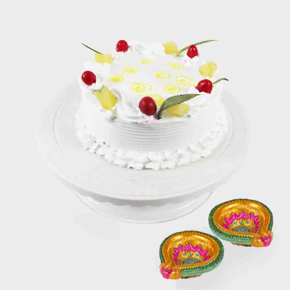 Round Pineapple Cake with 2 Diwali Diyas