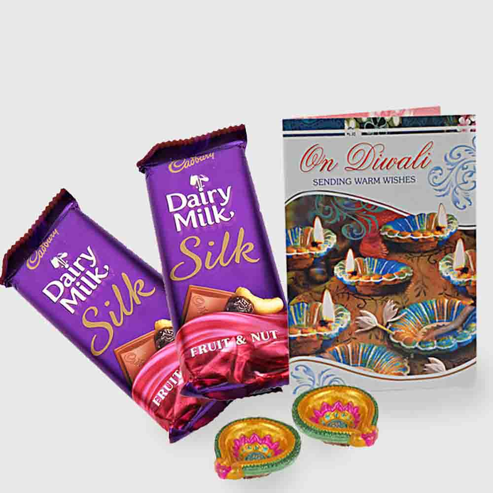 Floral Hampers-Cadbury dairy milk silk with card and diya