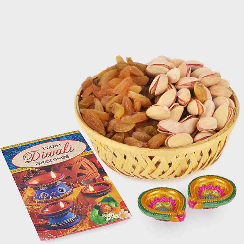 Basket of Raisins and pista with Diwali Diya