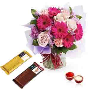 Flowers with Chocolates-Bhai Dooj Hamper of Mix Flowers in a Vase with Temptation Chocolate