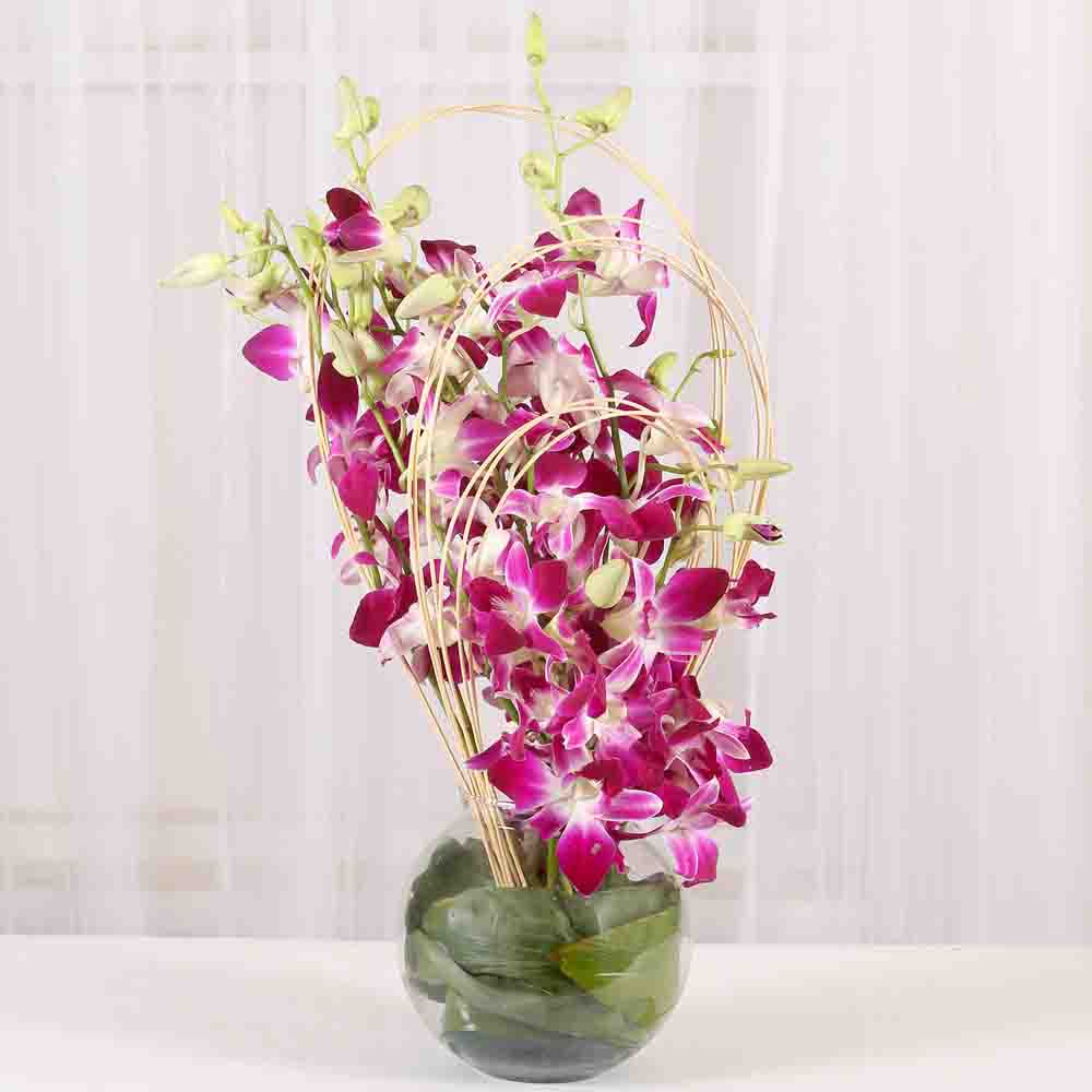 12 Purple orchids vase arrangement