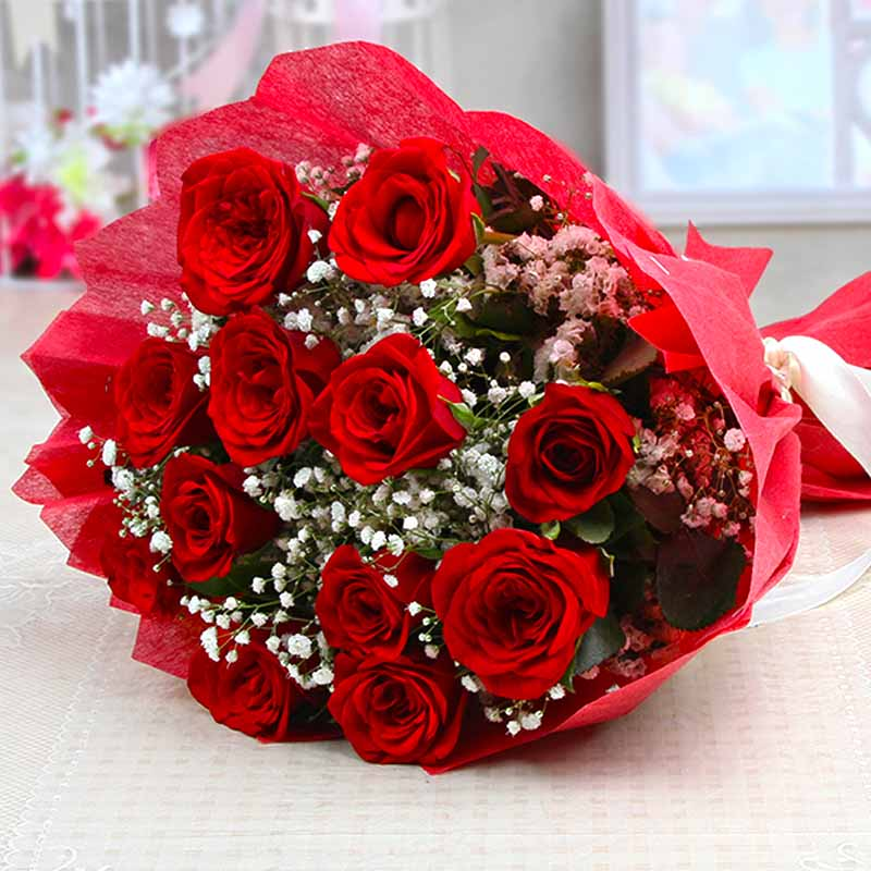 Loveable Twelve Red Roses Bouquet with Tissue Wrapping