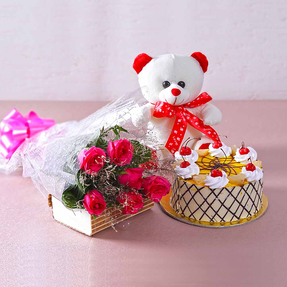 Bouquet of 6 Pink Roses with 1 kg Butterscotch Cake and Cuddly Bear