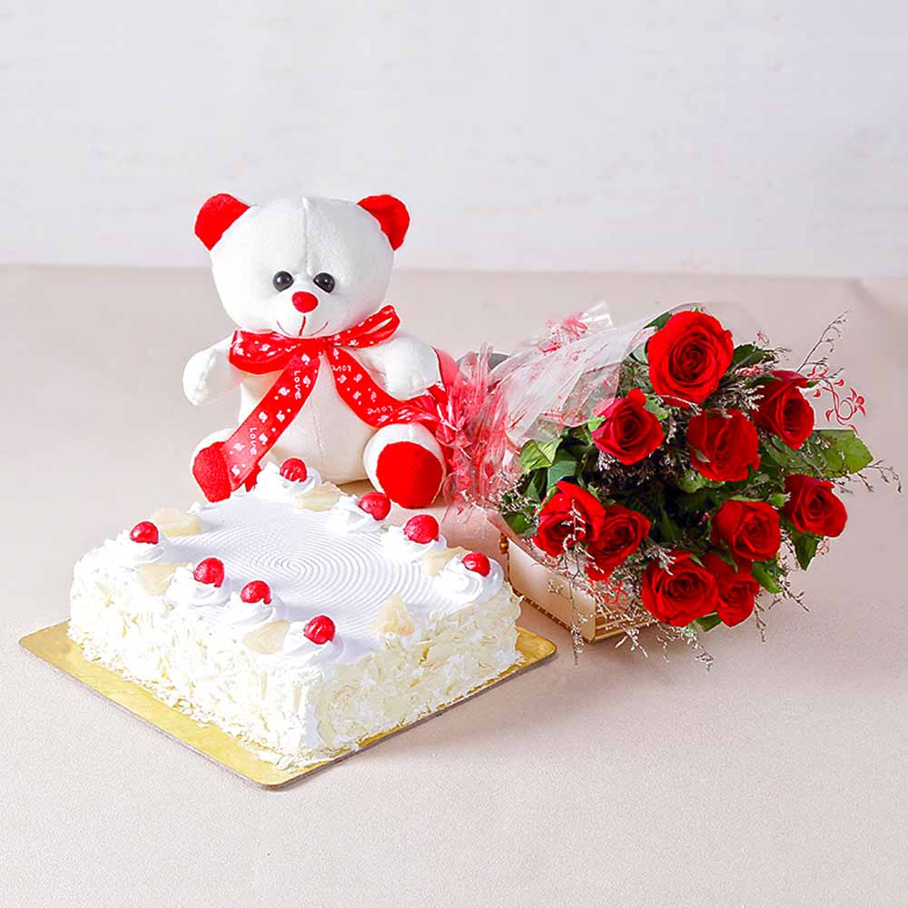 Ten Romantic Red Roses with One Kg Pineapple cake and Teddy Bear