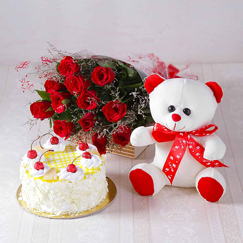 Cakes & Flowers-Forever Red Roses with Half kg Pineapple cake and Soft Toy