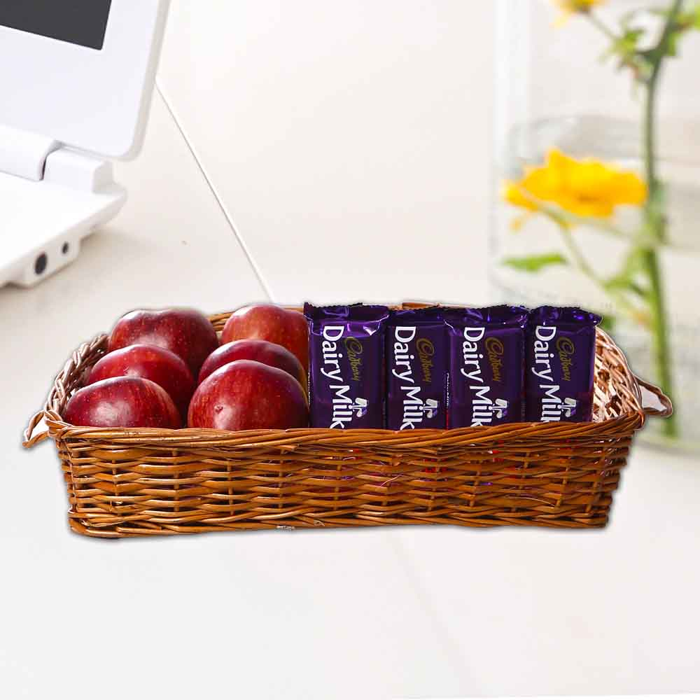 Apples in Basket along with Dairy Milk Chocolates