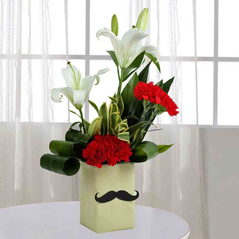 Designer Arrangements-Red Carnation N Leaves Arrangement