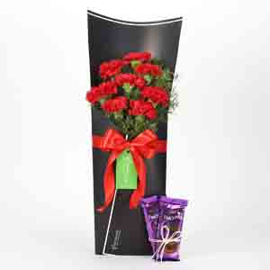 Chocolates & Flowers-8 Red Carnations Bouquet & Dairy Milk Silk Combo