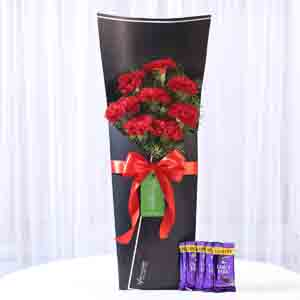Chocolates & Flowers-8 Red Carnations Bouquet & Dairy Milk Combo