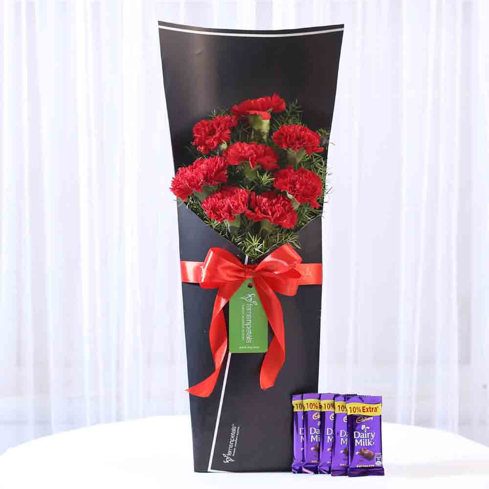 8 Red Carnations Bouquet & Dairy Milk Combo