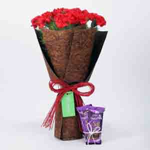 Chocolates & Flowers-12 Red Carnations Bouquet & Dairy Milk Silk Combo