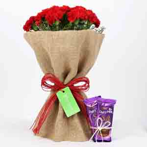 Chocolates & Flowers-Dairy Milk Silk & 12 Red Carnations Bouquet Combo