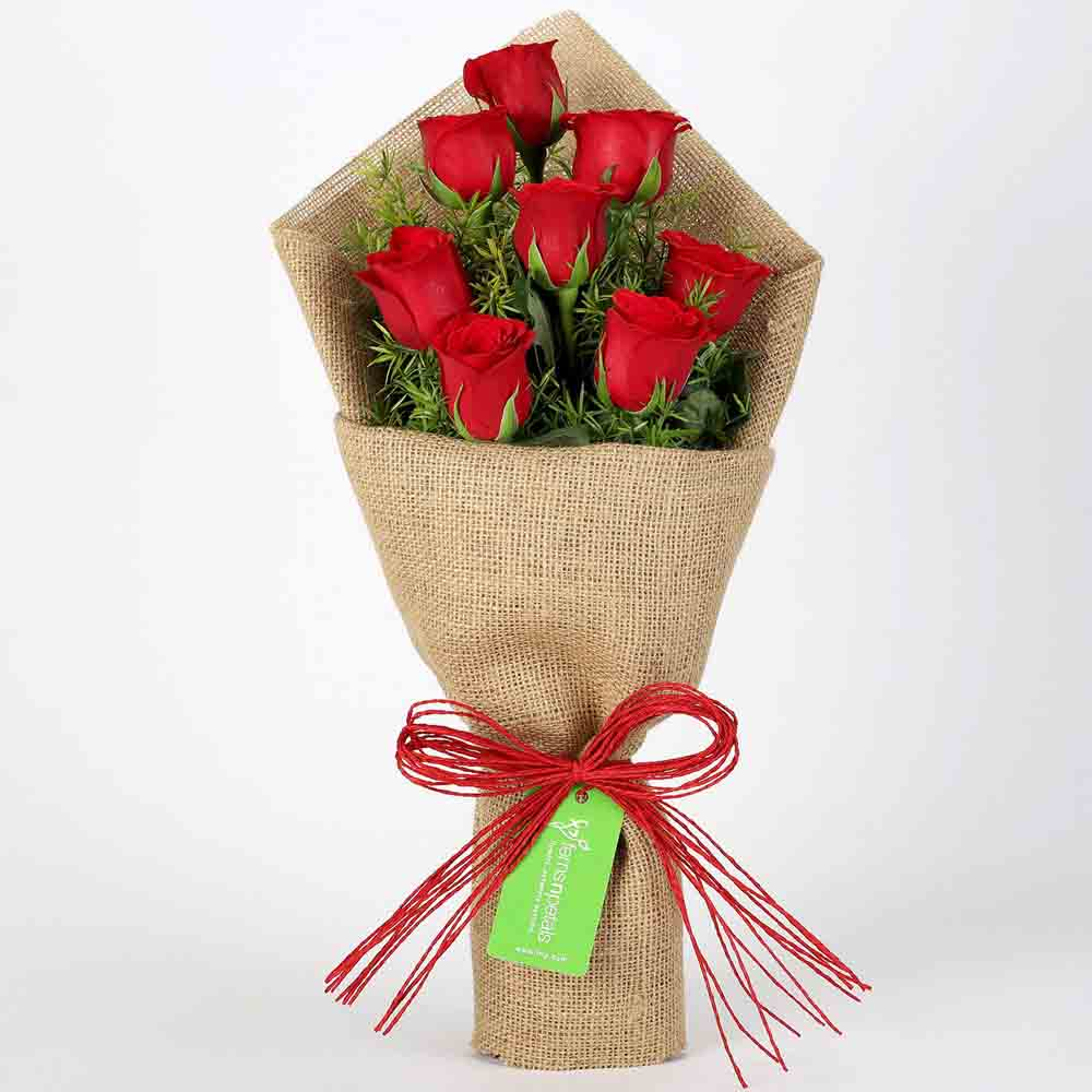 8 Red Roses in Jute Wrapping