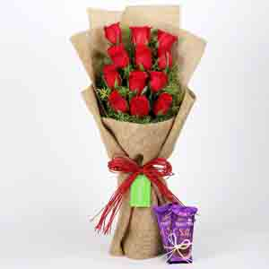 Chocolates & Flowers-12 Layered Red Roses Bouquet & Dairy Milk Silk