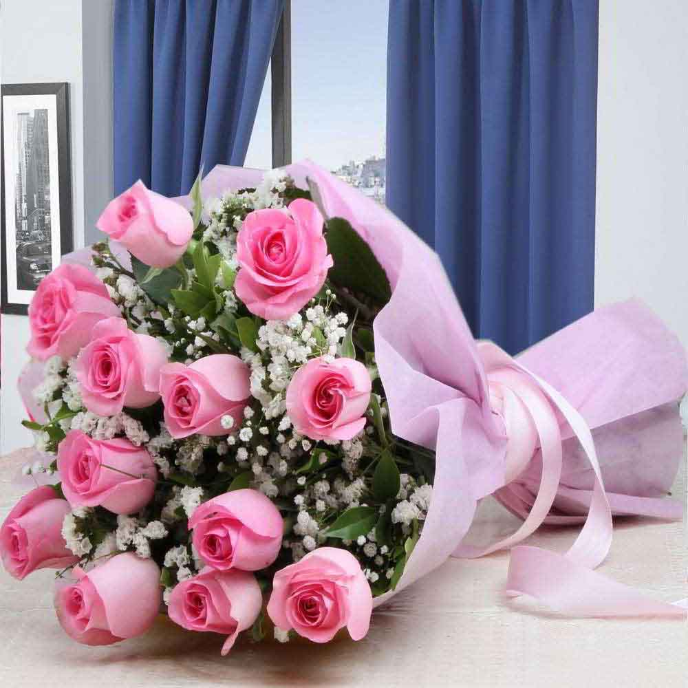 Moms Day Special Twelve Pink Roses Wrapped in Tissue