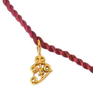 Royal Rakhi Collection-Trishul Shaped Gold Plated Sterling Silver Rakhi for Brothers SNSR9