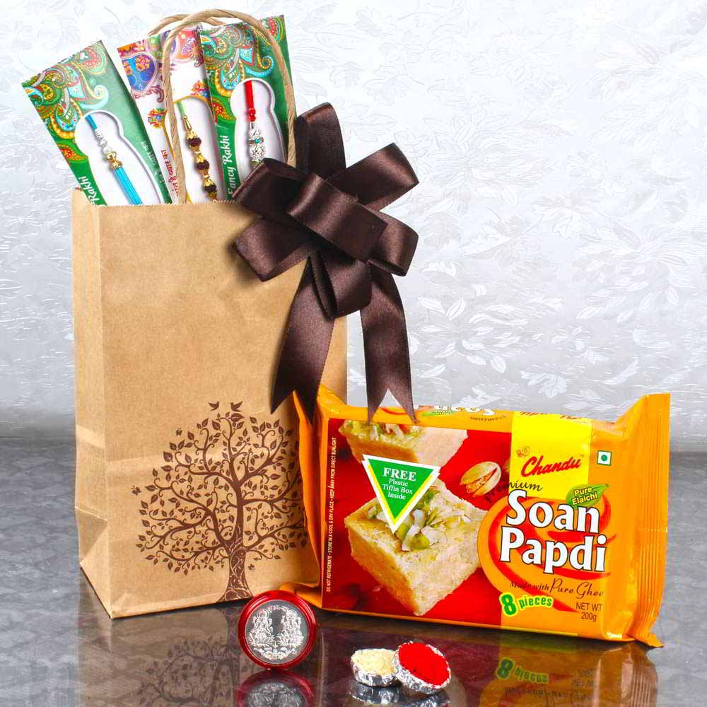 Rakhi Hampers-Three Designer Rakhis with Laxmi Ganesha Coin and Soan Papdi