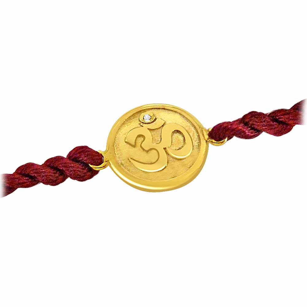 Royal Rakhi Collection-OM - Diamond and Gold Rakhi