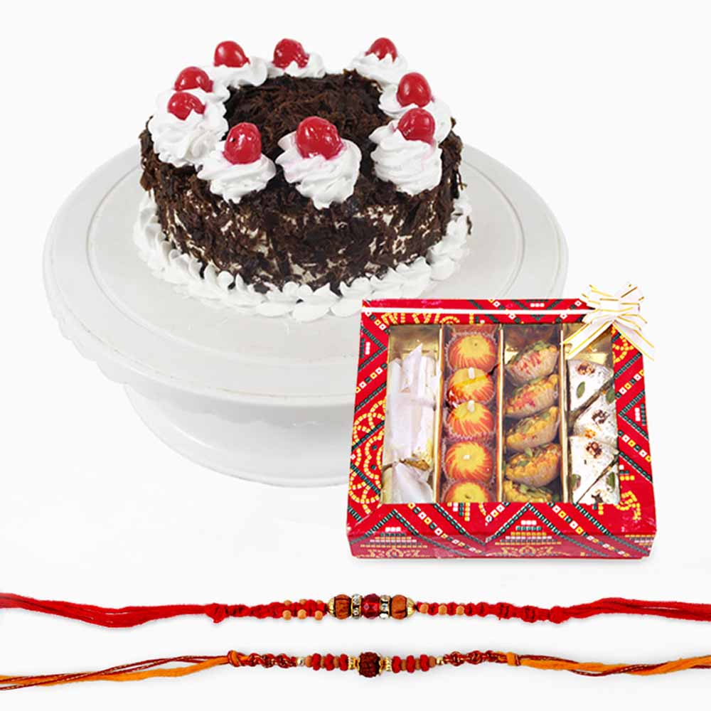 Rakhi Flower Hampers-Assorted Sweets with Set of Two Rakhi and Black Forest Cake