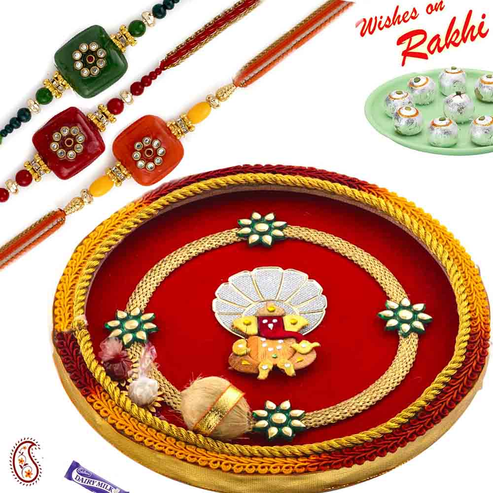 Beautiful Gat & Ganesh Motif Thali Hamper with Set of 3 Traditional Rakhis