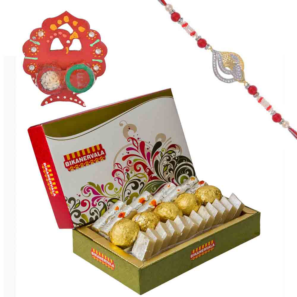 Auspicious Om American Diamond Rakhi with Bikanervala Assorted Sweets Hamper