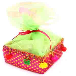 Rakhi Hampers-Colourful Englsih Brittles Chocolates Pouch with Red Pearl Rakhi