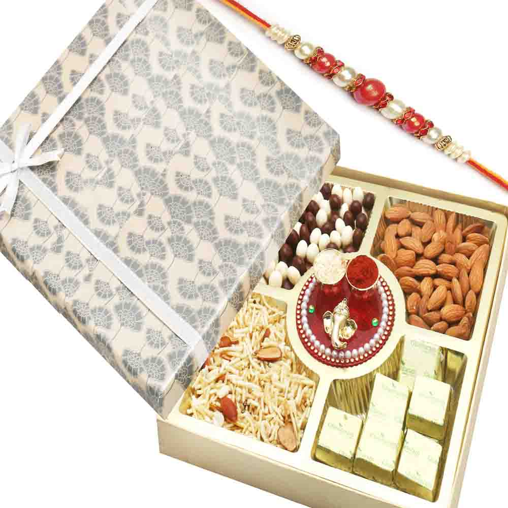 Grey Print Almonds, Namkeen, Nutties and Chocolate Box with Mini Pooja Thali and Red Pearl Rakhi