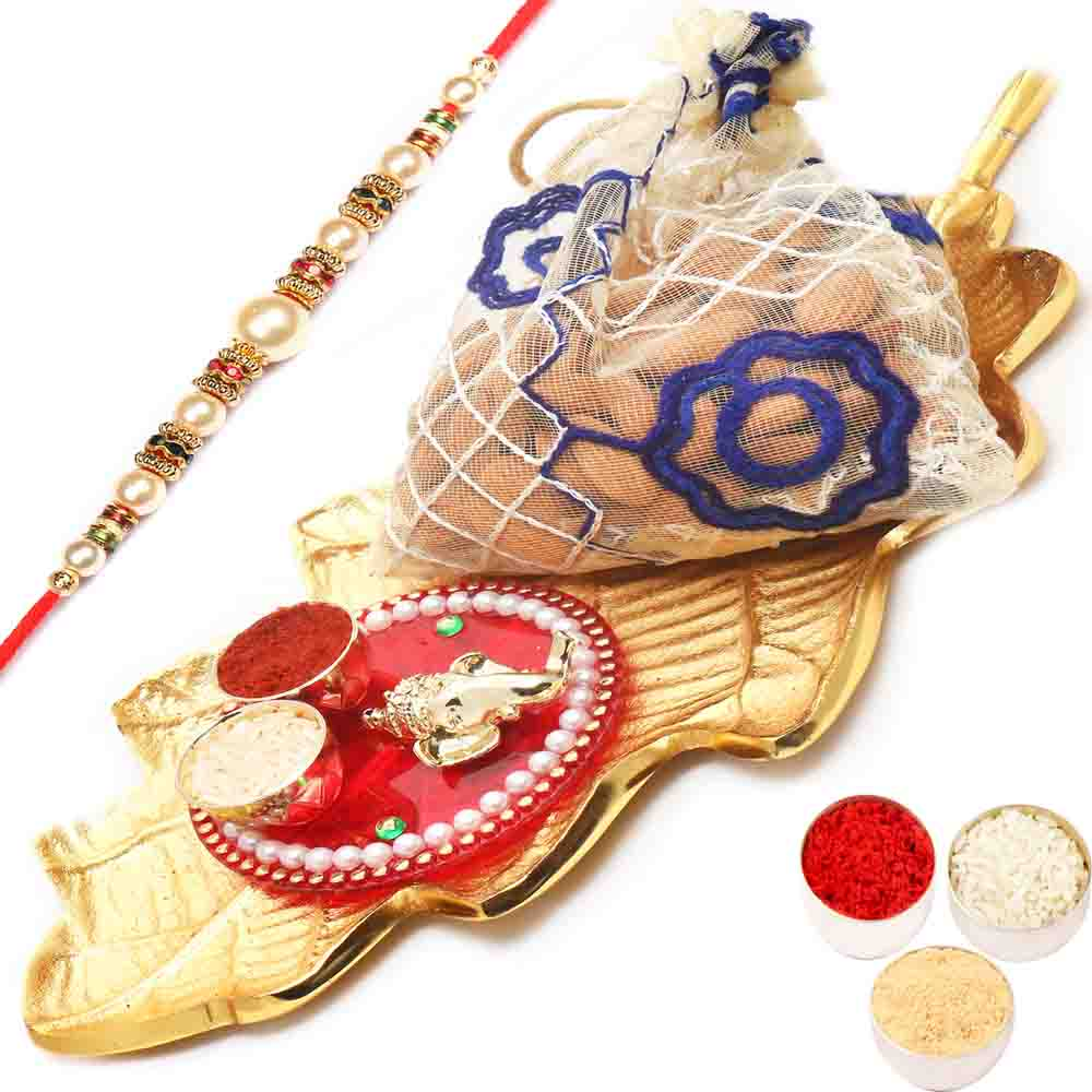 Gold Leaf Almonds Pouch Platter with Mini pooja Thali Hamper with Pearl Rakhi