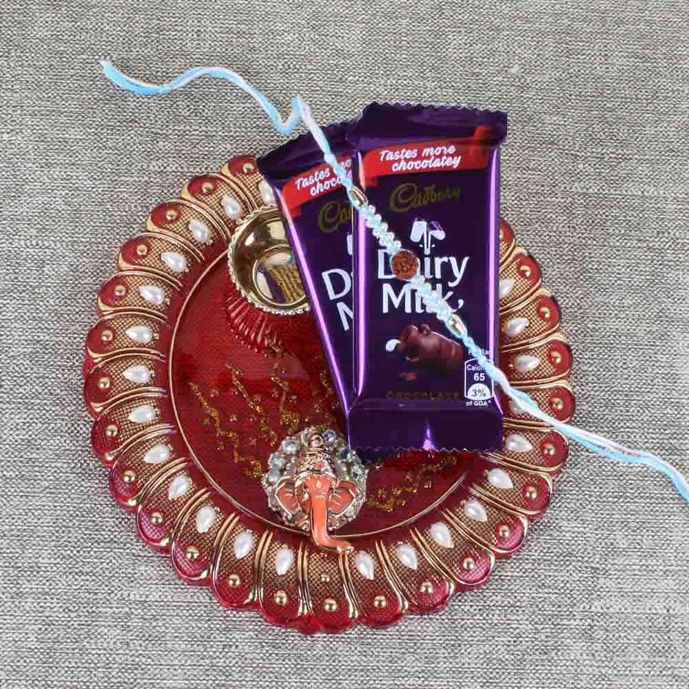 Thali with Cadbury Dairy Milk and Rudraksha Rakhi