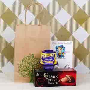 Rakhi Hampers-Cadbury Dairy Milk Lickables with Dark Fantasy Choco Fill Pack and Ganesha Krishna Rakhi
