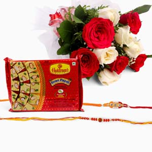 Mithai & Flowers-Bouquet of Ten White and Red Roses with Soan Papdi and Set of 2 Rakhi