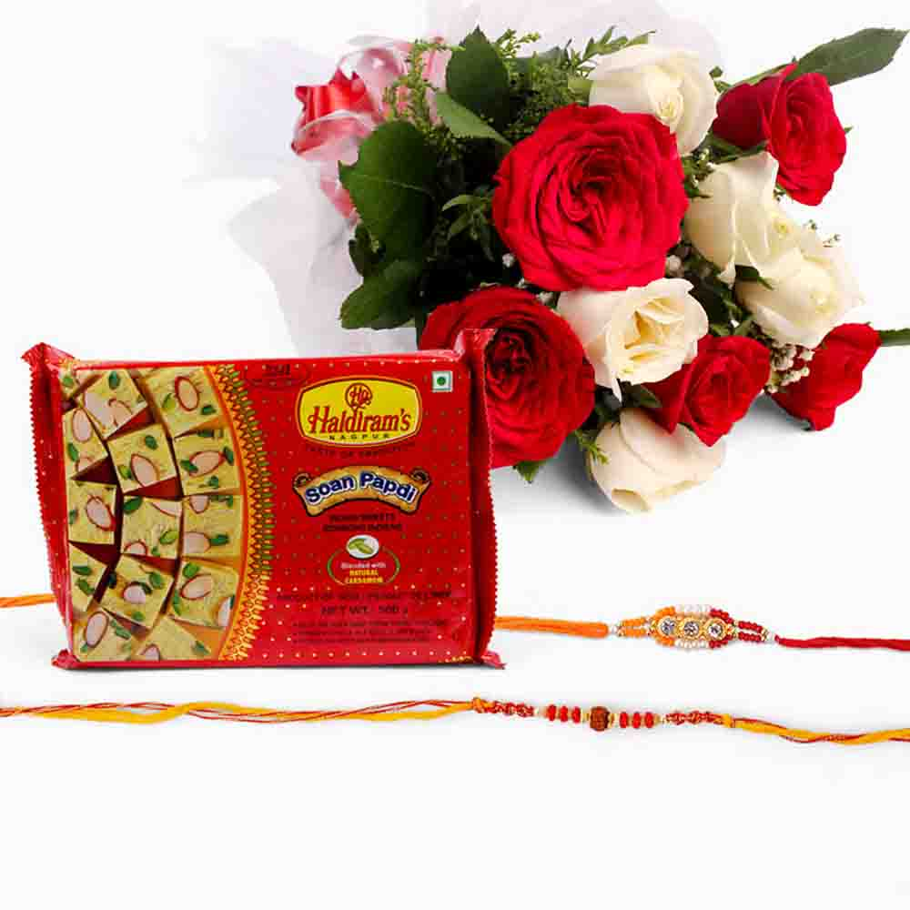 Bouquet of Ten White and Red Roses with Soan Papdi and Set of 2 Rakhi