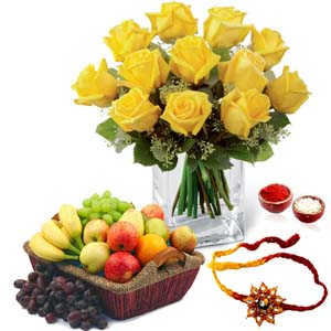 Flowers with Fruits-Yellow Roses Arrangement with Mix Fruits and Rakhi