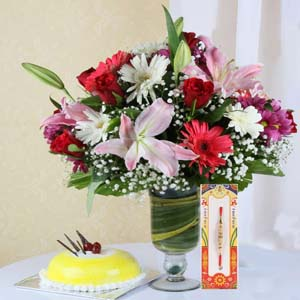 Cakes & Flowers-Mix Flowers with Rakhi and Pineapple Cake