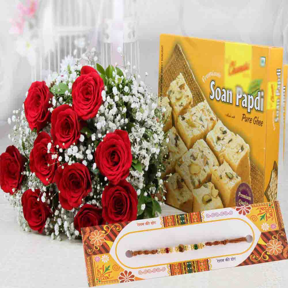 Rakhi with Red Roses Bouquet and Soan Papdi