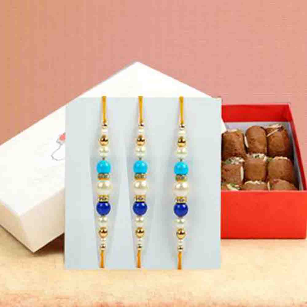 Three Designer Rakhi with Besan Ladoo