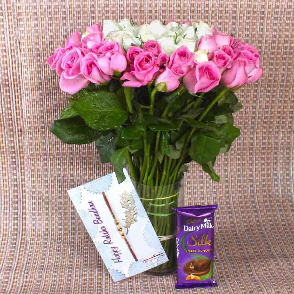 Chocolates & Flowers-Pink and White Roses arrangement with Chocolate and Rakhi