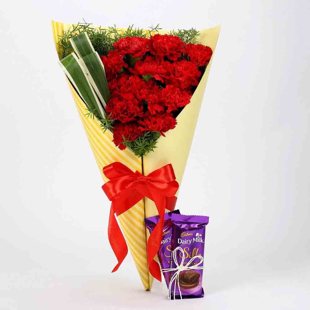 Flowers & Chocolates-12 Red Carnations & Dairy Milk Silk Combo
